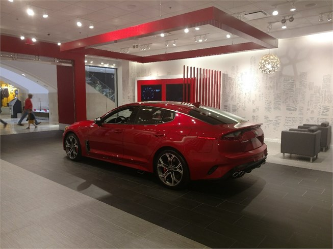 Kia motors to open interactive stinger saloons ancira for Showcase motors san antonio